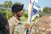 Capt. Ryan Sanders, outgoing commander, Houston Medical Recruiting Company, passes the guidon during the Houston Medical Recruiting Company change of command ceremony, at Hermann Park Conservancy, Houston, Texas, Sept. 5.