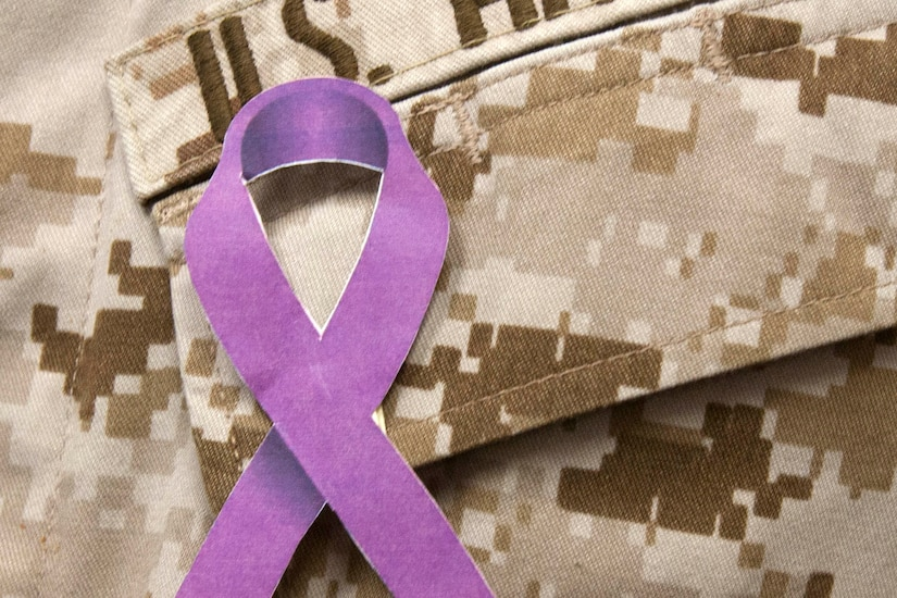 A purple ribbon on a military uniform.
