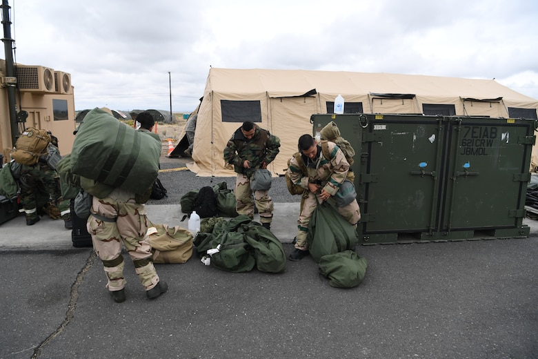 U.S. Air Force Aircrew Flight Equipment Airmen arrive at Yakima Air Terminal-McAllister Field, Washington to perform decontamination procedures on KC-135 Stratotanker aircrew and passengers during Exercise Mobility Guardian, Sept. 16, 2019. Exercise Mobility Guardian is Air Mobility Command's premier, large scale mobility exercise. Through robust and relevant training, Mobility Guardian improves the readiness and capabilities of Mobility Airmen to deliver rapid global mobility and builds a more lethal and ready Air Force. (U.S. Air Force photo by Tech. Sgt. Luther Mitchell)