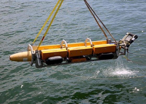 A view of an unmanned underwater vehicle (UUV) Knightfish being recovered by Military Sealift Command's expeditionary sea base