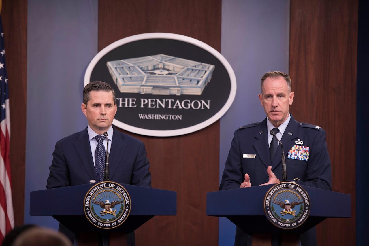 Two men address Pentagon reporters.