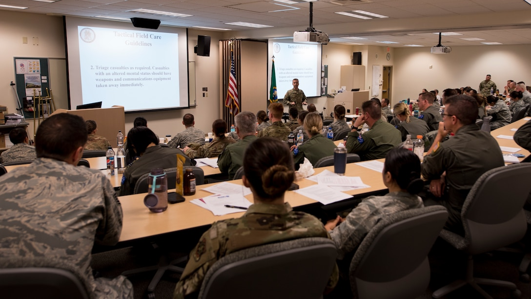 Students of the Tactical Combat Casualty Care course attend their first day of instruction by reviewing Department of Defense guidelines and current practices at Fairchild Air Force Base, Washington, Sept. 12, 2019. The TCCC is the replacement for the former Self-Aid Buddy Care training and will become the new standard across all U.S. military service branches. (U.S. Air Force photo by Senior Airman Ryan Lackey)