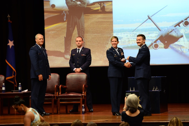 Col. Samantha Weeks, 14th Flying Training Wing commander, presents 2nd Lt. Julius Peek III his certificate of graduation, Sept. 13, 2019, on Columbus Air Force Base, Mississippi. After graduating pilot training at Columbus AFB, pilots will now go to their specified base to start training on their assigned aircraft. (U.S. Air Force photo by Airman 1st Class Jake Jacobsen)