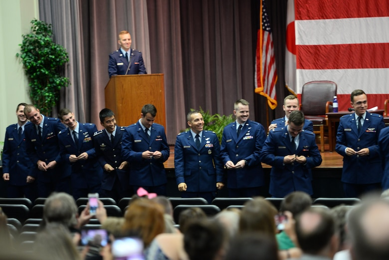 Graduating class 19-23/24 break their silver wings, Sept. 13, 2019, on Columbus Air Force Base, Mississippi. This process is an honored tradition where new Air Force pilots break their first set of Silver Wings for good luck, and the two halves are not supposed to be reunited until the pilot is deceased. (U.S. Air Force photo by Airman 1st Class Jake Jacobsen)