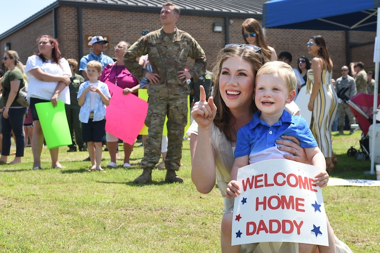 A mother and her son await the return of an Airman.