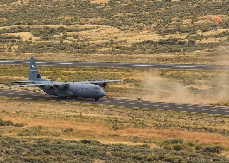 A U.S. Air Force C-130 Hercules from Little Rock Air Force Base, Arkansas, lands on a runway to deliver Humvees, cargo, and U.S. Air Force Airmen for a Joint Forcible Entry operation during Air Mobility Command's Mobility Guardian exercise.