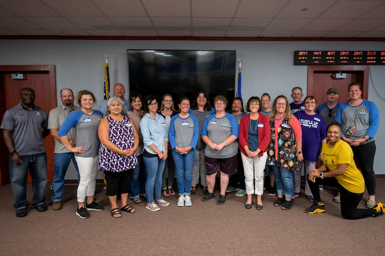 Members of Cannon Air Force Base and its local schools pose for a photo at the end of Teachers Understanding Deployment Operations at Cannon Air Force Base, N.M, Sept. 14, 2019. TUDOS is a program made to educate teachers and faculty of local schools about what military life is like and how it can affect the children of military members. (U.S. Air Force photo by Senior Airman Vernon R. Walter III)