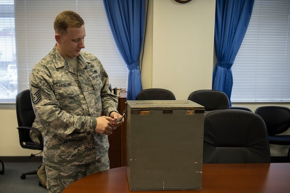 Master Sgt. John Freeling, 374th Contracting Squadron contracting officer, opens a bidding lockbox on Sept. 13, 2019, at Yokota Air Base, Japan.