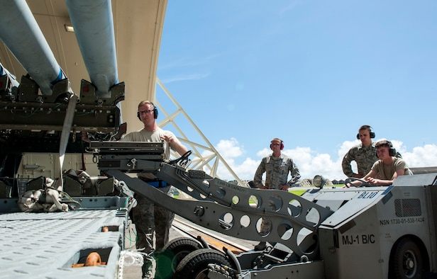 U.S. Air Force Airman Staff Sgt. Jeremy Devlin, 44th Aircraft Maintenance Unit weapons load crew chief, loads an AIM-120 advanced medium-range air-to-air missile onto an MJ-1C lift truck during initial certification training at Kadena Air Base, Japan, Sept. 11, 2019. The 18th Maintenance Group provides training for more than 2,000 aircraft maintainers and munitions handlers. The group also provides maintenance support and facilities for all other forces assigned to or transiting to Kadena AB. (U.S. Air Force photo by Naoto Anazawa)