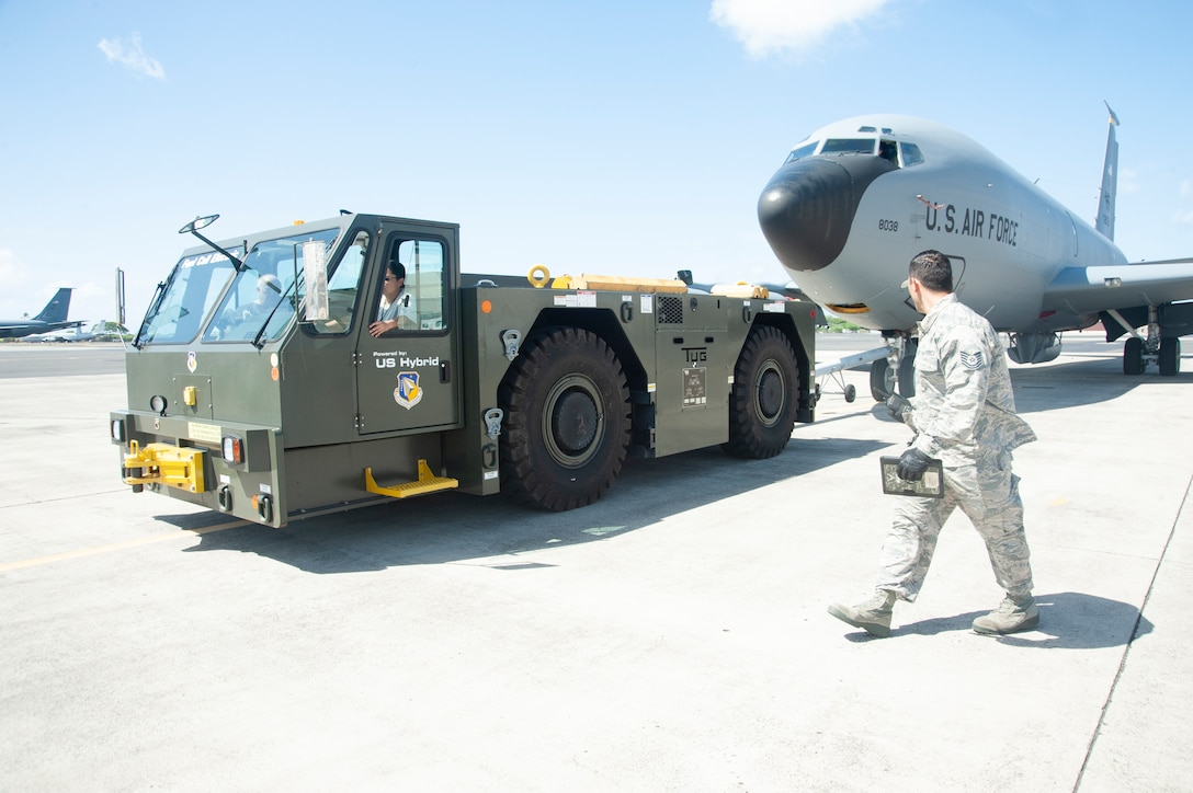 A 154th Maintenance Squadron crew chief does a final walk-around inspection before a U-30 Aircraft Tow Tractor powered by hydrogen fuel cell technology tows the aircraft, July 18, 2019, Joint Base Pearl Harbor-Hickam, Hawaii.