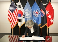 Foreign Minister Kang Kyung-wha, Ministry of Foreign Affairs signs the guest book in the Armistice Room, United Stated Forces Headquarters, Camp Humphreys. Her visit emphasizes the commitment the ROK and U.S. have to maintaining an unbreakable alliance.