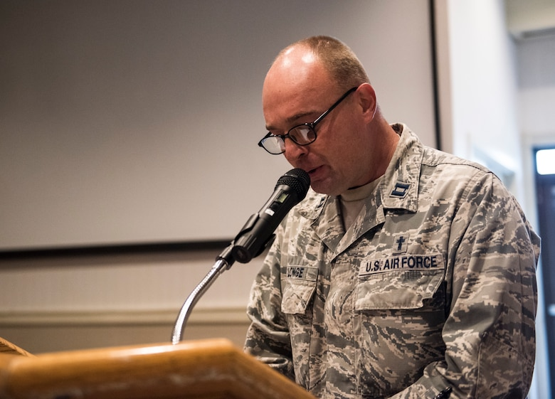 U.S. Air Force Capt. James Longe, 8th Fighter Wing chaplain, gives an invocation during a prisoners of war and missing in action memorial ceremony at Kunsan Air Base, Republic of Korea, Sept. 20, 2019. Leaders from the Wolf Pack and Republic of Korea Air Force's 38th Fighter Group came together to honor those who are still lost but not forgotten. (U.S. Air Force photo by Senior Airman Stefan Alvarez)