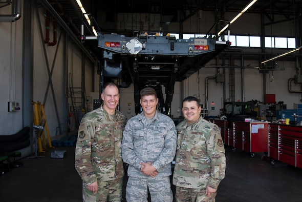 U.S. Air Force Col. Matthew S. Husemann, 86th Airlift Wing vice commander, and Chief Master Sgt. Ernesto J. Rendon, 86th AW command chief, recognize Airman 1st Class Kamil Roginski, 86th Vehicle Readiness Squadron materiel handling equipment journeyman, as Airlifter of the Week at Ramstein Air Base, Germany, Sept. 19, 2019.