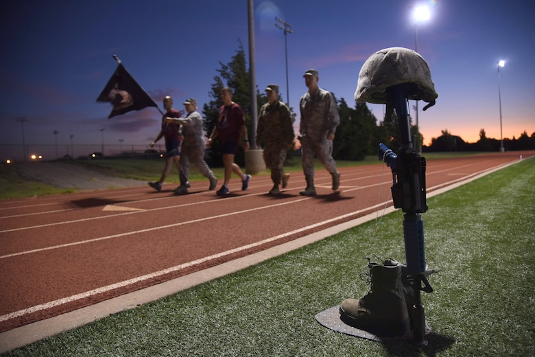 An image of Tinker senior leaders participating in the POW-MIA vigil.