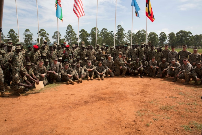 U.S. Marines and Sailors and Uganda People's Defense Force Soldiers pose for a group photo after a closing ceremony at Camp Singo, Uganda, Aug. 29, 2019. Marines and Sailors Special Purpose Marine Air-Ground Task Force-Crisis Response-Africa 19.2, Marine Forces Europe and Africa, have advised the UPDF soldiers on logistics and small unit tactics courses. The courses lasted 16 weeks with Marine advisors providing mentorship and guidance to a cadre of UPDF instructors. (U.S. Marine Corps photo by Staff Sgt. Mark E Morrow Jr.)