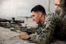 A U.S. Marine with Special Purpose Marine Air-Ground Task Force-Crisis Response-Africa 19.2, Marine Forces Europe and Africa, loads an M110 semi-automatic sniper system at Moron Air Base, Spain, Aug. 30, 2019. Marines conducted training to increase marksmanship proficiency on their sniper system. SPMAGTF-CR-AF is deployed to conduct crisis-response and theater-security operations in Africa and promote regional stability by conducting military-to-military training exercises throughout Europe and Africa. (U.S. Marine Corps photo by Cpl. Margaret Gale)