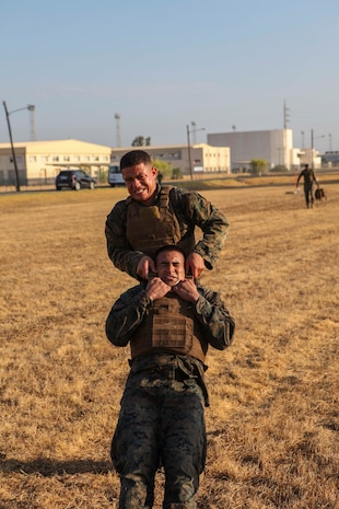 A U.S. Marine with Special Purpose Marine Air-Ground Task Force-Crisis Response-Africa 19.2, Marine Forces Europe and Africa, executes buddy-lifts for combat-conditioning during Marine Corps Martial Arts Instructor Course at Moron Air Base, Spain, Sept. 5, 2019. MAIC is a knowledge-driven course that teaches proper Marine Corps Martial Arts Program techniques and builds the ethical warrior mindset. SPMAGTF-CR-AF is deployed to conduct crisis-response and theater-security operations in Africa and promote regional stability by conducting military-to-military training exercises throughout Europe and Africa. (U.S. Marine Corps photo by Capt. Clay Groover)
