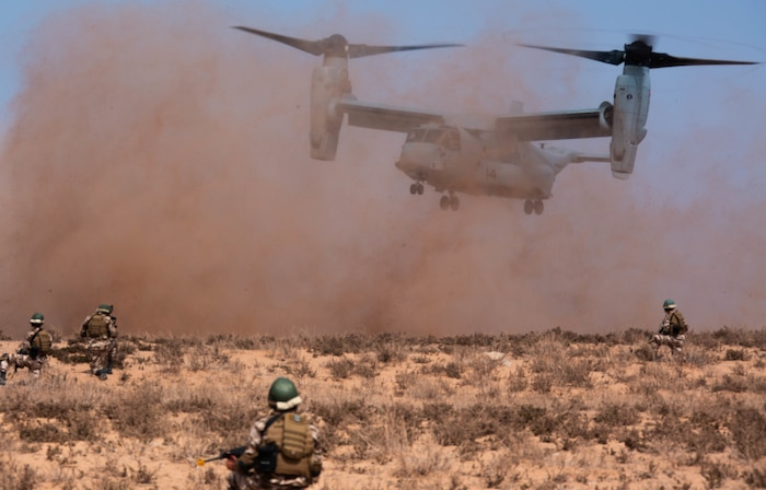 Members of the Royal Moroccan Armed Forces secure a landing zone while a U.S. Marine Corps MV-22B Osprey with Special Purpose Marine Air-Ground Task Force-Crisis Response-Africa 19.2, Marine Forces Europe and Africa, lands in Tifnit, Morocco, during a tactical recovery of aircraft and personnel exercise, Sept. 10, 2019. TRAP is a core function of a crisis-response force and SPMAGTF-CR-AF 19.2 consistently trains to increase TRAP proficiency by rehearsing realistic scenarios. SPMAGTF-CR-AF is deployed to conduct crisis-response and theater-security operations in Africa and promote regional stability by conducting military-to-military training exercises throughout Europe and Africa. (U.S. Marine Corps photo by Cpl. Gumchol Cho)