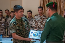 A U.S. Marine with Special Purpose Marine Air-Ground Task Force-Crisis Response-Africa 19.2, Marine Forces Europe and Africa, presents a certificate of appreciation to a member of the Royal Moroccan Armed Forces following a tactical recovery of aircraft and personnel exercise, Sept. 11, 2019, in Tifnit, Morocco. TRAP is a core function of a crisis-response force and SPMAGTF-CR-AF 19.2 consistently trains to increase TRAP proficiency by rehearsing realistic scenarios. SPMAGTF-CR-AF is deployed to conduct crisis-response and theater-security operations in Africa and promote regional stability by conducting military-to-military training exercises throughout Europe and Africa. (U.S. Marine Corps photo by Capt. Clay Groover)
