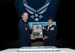 COLUMBUS, Ohio – Defense Logistics Agency Land and Maritime Chief of Staff Air Force Col. Janette Ketchum presents Col. Kevin Cullen with a token of appreciation during the Defense Supply Center Columbus' Air Force birthday event Sept. 18. Cullen commands The Ohio State University's Air Force Reserve Officer Training Corps and is a professor of aerospace studies.