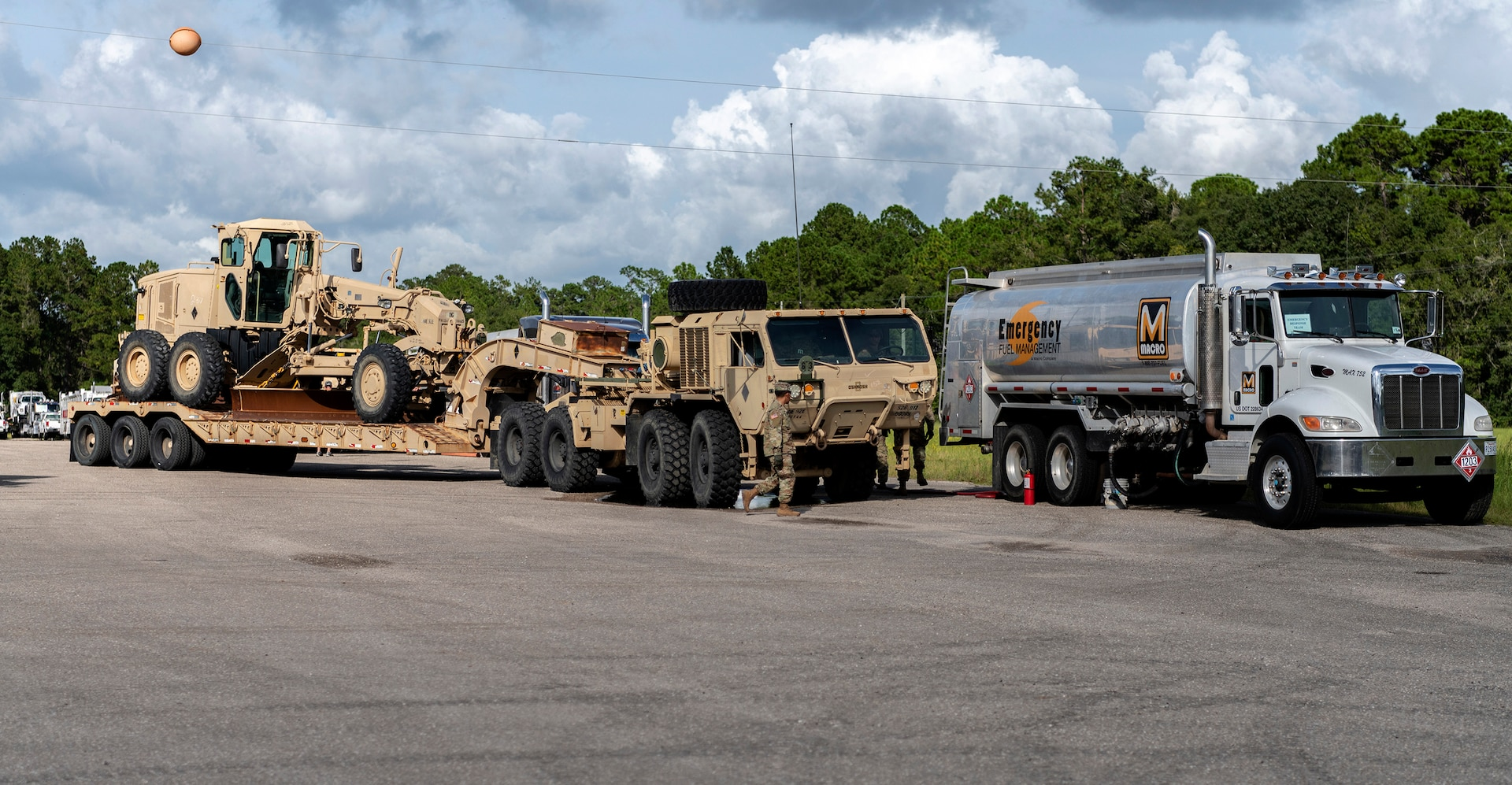 Soldiers from the 92nd Engineer Battalion, based at Fort Stewart, Georgia, refuel their vehicles after arriving in Camp Blanding, Florida, for Hurricane Dorian support Sept. 3.