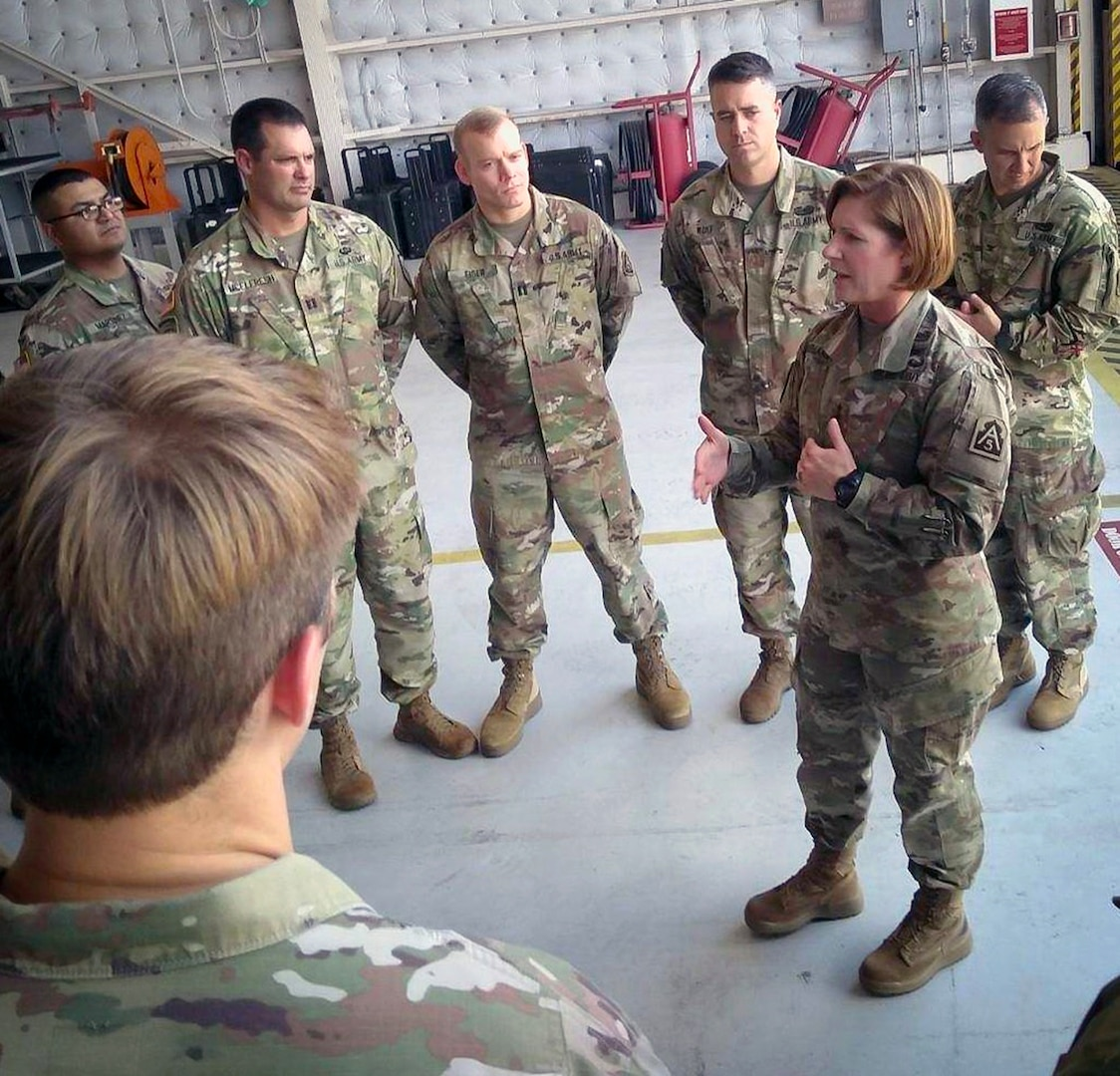 Lt. Gen. Laura Richardson, commander, U.S. Army North, talks to Soldiers during her visit with states leaders impacted by Hurricane Dorian at Homestead Air Reserve Base, Florida, Sept. 6. Army North helps protect the nation by coordinating active duty military support to state and federal partners during disasters.