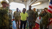 Grenadian Prime Minister Keith Mitchell takes a tour of the hospital ship USNS Comfort.
