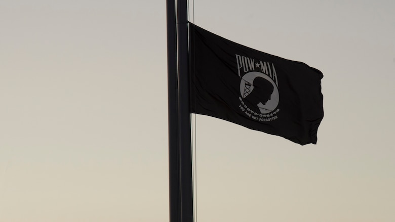 The POW/ MIA Flag waves over MacDill Air Force Base, Sept. 20, 2019. POW/MIA Recognition Day is commemorated nationally on the third Friday of every September in honor of service members who were prisoners of war as well as those missing in action. (U.S. Air Force photo by Airman 1st Class Shannon Bowman)