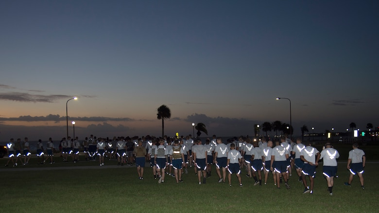 U.S. Air Force Airmen walk towards the starting line during the MacDill Air Force Sergeants Association's POW/ MIA Recognition Day 5K, Sept. 20, 2019, at MacDill Air Force Base, Fla. POW/MIA Recognition Day is commemorated nationally on the third Friday of every September in honor of service members who were prisoners of war as well as those missing in action. (U.S. Air Force photo by Airman 1st Class Shannon Bowman)