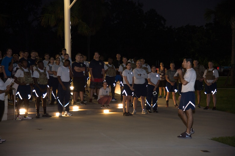 U.S. Air Force Col. Benjamin Robins, the 6th Air Mobility Wing vice commander, gives opening remarks prior to a POW/ MIA Recognition Day 5K, Sept. 20, 2019, at MacDill Air Force Base, Fla.  POW/MIA Recognition Day is commemorated nationally on the third Friday of every September in honor of service members who were prisoners of war as well as those missing in action. (U.S. Air Force photo by Airman 1st Class Shannon Bowman)