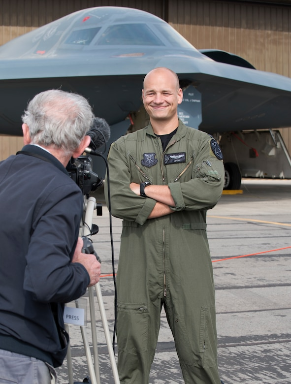 Captain Erik Leitzel, a B-2 Spirit pilot assigned to the 393rd Bomb Squadron at Whiteman Air Force Base, Missouri, stands for an interview with a British journalist on August 30, 2019, at Royal Air Force Fairford, England. Leitzel is a third-generation bomber pilot, following his grandfather and father, two retired Air Force colonels, who also served at or near RAF Fairford during their respective careers. (U.S. Air Force photo by Staff Sergeant Kayla White)