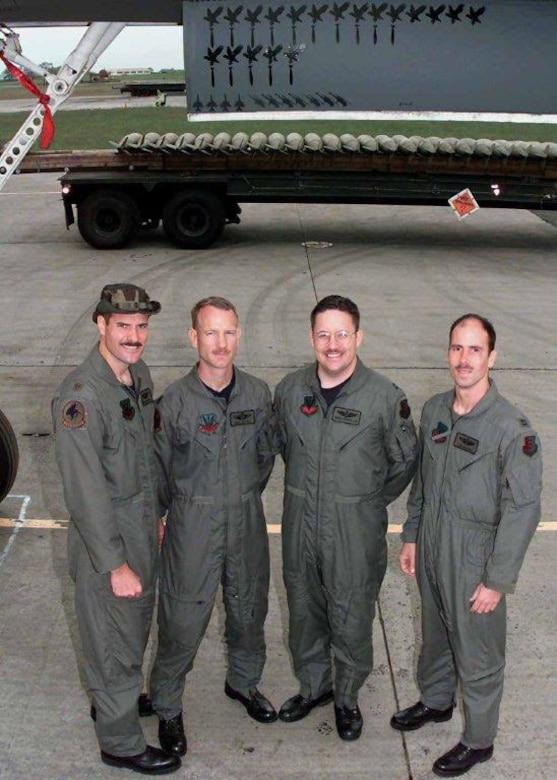 Ben Leitzel (second from left), father of Captain Erik Leitzel, a pilot assigned to the 393rd Bomb Squadron at Whiteman Air Force Base, Missouri, poses for a photo with his crew before a mission in 1999. The retired colonel flew 16 B-1 combat sorties During Operation Allied Force out of Royal Air Force Fairford, where his own son would later serve. Erik Leitzel continued his family's aviator legacy when he became a third-generation bomber pilot, flying the B-2 Spirit, the U.S. Air Force's premier stealth bomber. (Courtesy photo)