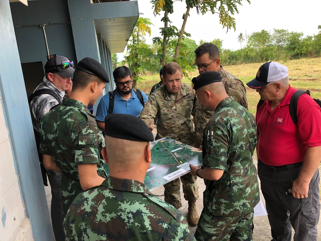 US and Thai engineer officers review the map during the Si Racha site survey, 22 August 2019