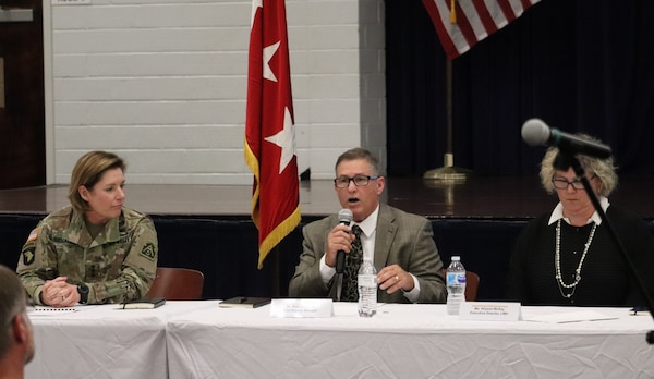 Mike Mathews (center), Army Support Activity deputy manager, updates residents on changes his office has made to provide better oversight of the privatized housing contractor at Joint base San Antonio-Fort Sam Houston during a town hall Sept. 18.