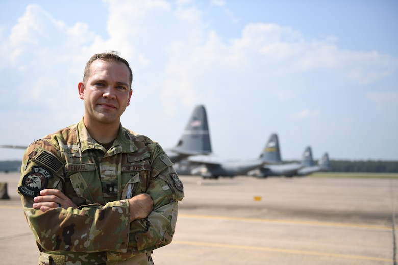 An Airman poses for a photo on the flight line.