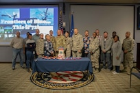 "Members of the U.S. Air Force, both past and present, gather for a group photo during the 72nd Air Force birthday celebration at Joint Task Force Civil Support headquarters. The theme for this year's celebration is ""Frontiers of Blue…this is 72!"" which focuses on heritage, warfighting capability and innovation. (Official DoD photo by Mass Communication Specialist 3rd Class Michael Redd/RELEASED)"
