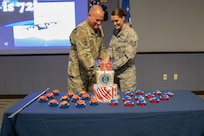 "Joint Task Force Civil Support Command Senior Enlisted Leader Chief Master Sgt. James Brown and Tech. Sgt. Jordan Daniels cut a cake during the 72nd Air Force birthday celebration at the command's headquarters. The theme for this year's celebration is ""Frontiers of Blue…this is 72!"" which focuses on heritage, warfighting capability and innovation. (Official DoD photo by Mass Communication Specialist 3rd Class Michael Redd/RELEASED)"