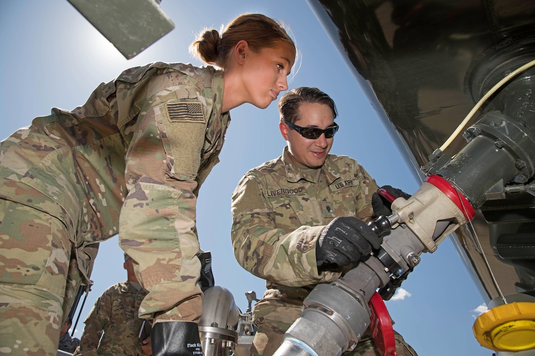Army Soldiers attach a fuel hose to a truck at Peterson Air Force Base, Colorado, September 6, 2019.