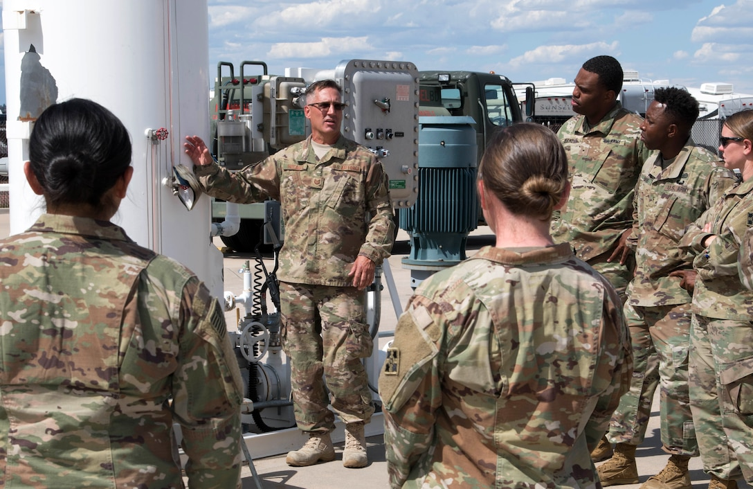 An Air Force Reservists speaks with Army Soldiers from Fort Carson at Peterson Air Force Base, Colorado, September 6, 2019.