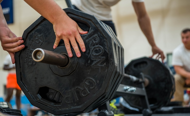 volunteers prep weights for competition