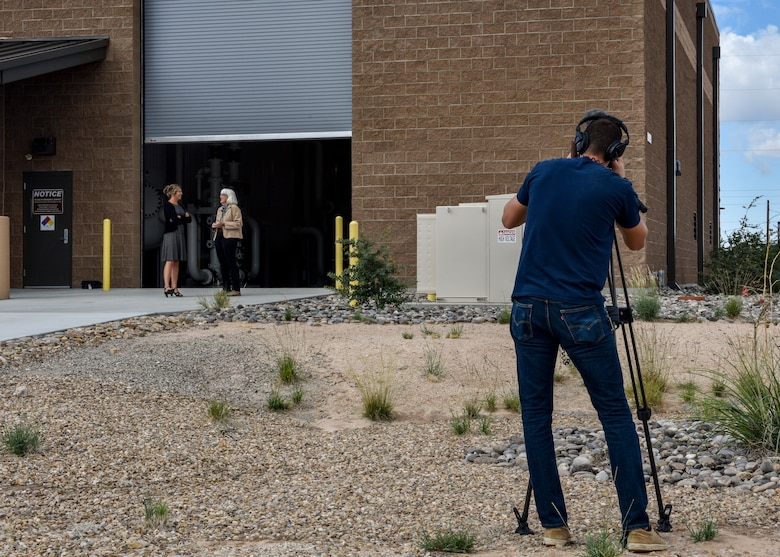 Antony Lostetter (right), New Mexico Public Broadcasting Service production manager, films an interview at Kirtland Air Force Base, N.M., Sept. 16, 2019. PBS filmed a news story at Kirtland's groundwater treatment facility concerning what has been done to clean up the fuel spill. (U.S. Air Force photo by Airman 1st Class Austin J. Prisbrey)