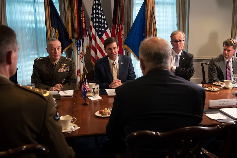 A group of men sitting at a table.