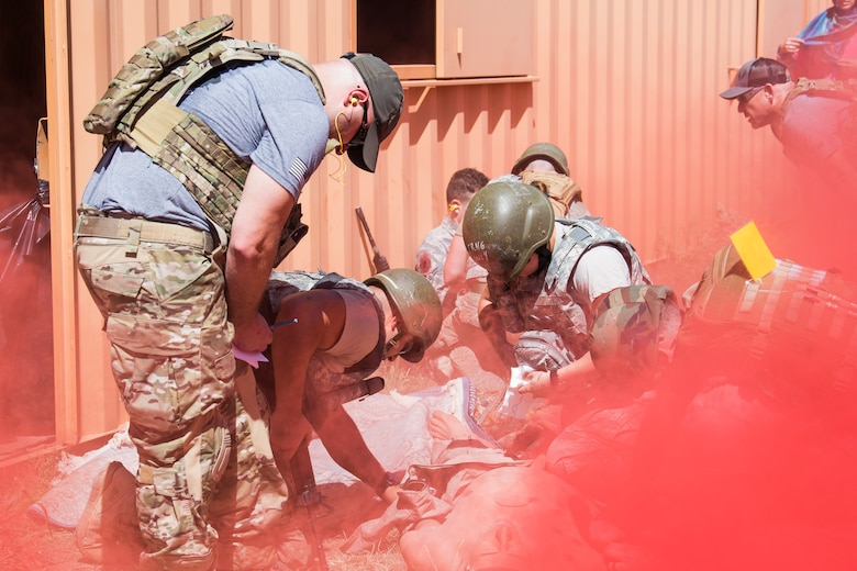 Medical technicians attempt to stabilize a victim in a mock improvised explosive device attack scenario at the Cannon Air Force Base Medic Rodeo, Melrose Air Force Range, N.M., Sept. 18, 2019. The Medic Rodeo is designed to test the skills of Air Force medical technicians in both deployed and home installation environments. (U.S. Air Force photo by Senior Airman Vernon R. Walter III)