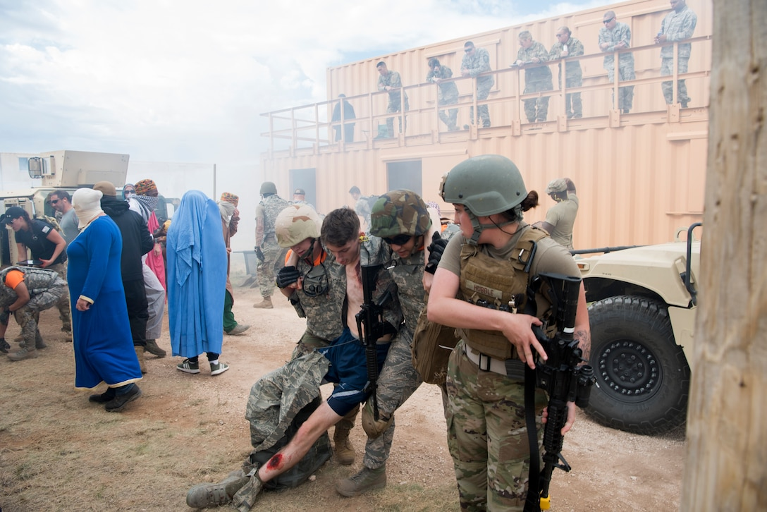 Two medical personnel from MacDill Air Force Base, Fla., carry a mock wounded military member during a scenario at the 2019 Medic Rodeo at Melrose Air Force Range, N.M., Sept. 19, 2019. A total of 19 medical teams from around the world competed in the rodeo, which is designed to test and improve their skills in both deployed and home installation environments. (U.S. Air Force photo by Staff Sgt. Michael Washburn)