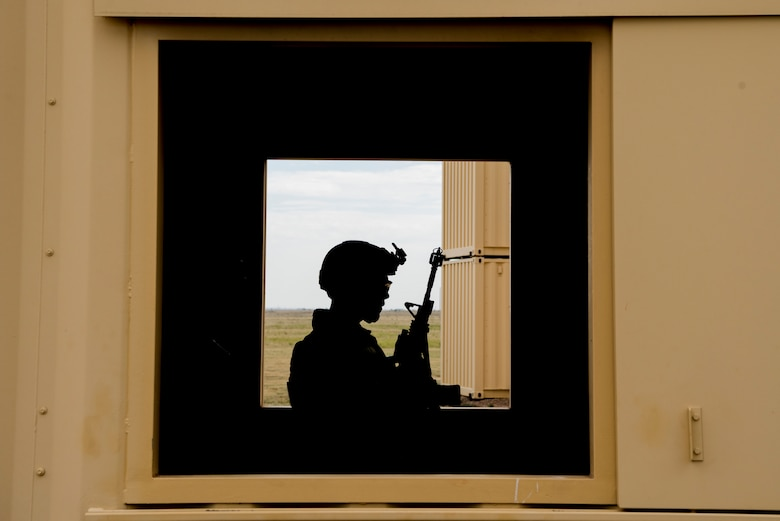 Staff Sgt. Nestor Albalos, 27th Special Operations Security Forces Squadron Deployed Aircraft Ground Response Element team member, relaxes by a window before a scenarios starts during the 2019 Medical Rodeo at Melrose Air Force Range, N.M., Sept. 19, 2019. The Medic Rodeo is designed to test the skills of air force medical technicians in both deployed and home installation environments. (U.S. Air Force photo by Staff Sgt. Michael Washburn)