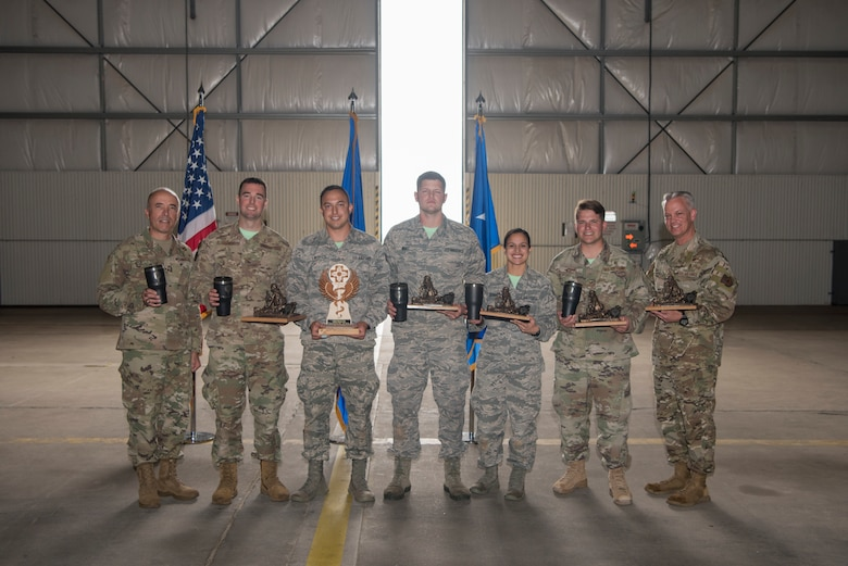 Medical technicians from Hurlburt Field, Fla., hold their trophies after winning first place at the 2019 Medical Rodeo closing ceremonies at Cannon Air Force Base, N.M., Sept. 20, 2019. A total of 19 medical teams from around the world competed in the rodeo, which is designed to test and improve their skills in both deployed and home installation environments. (U.S. Air Force photo by Staff Sgt. Michael Washburn)
