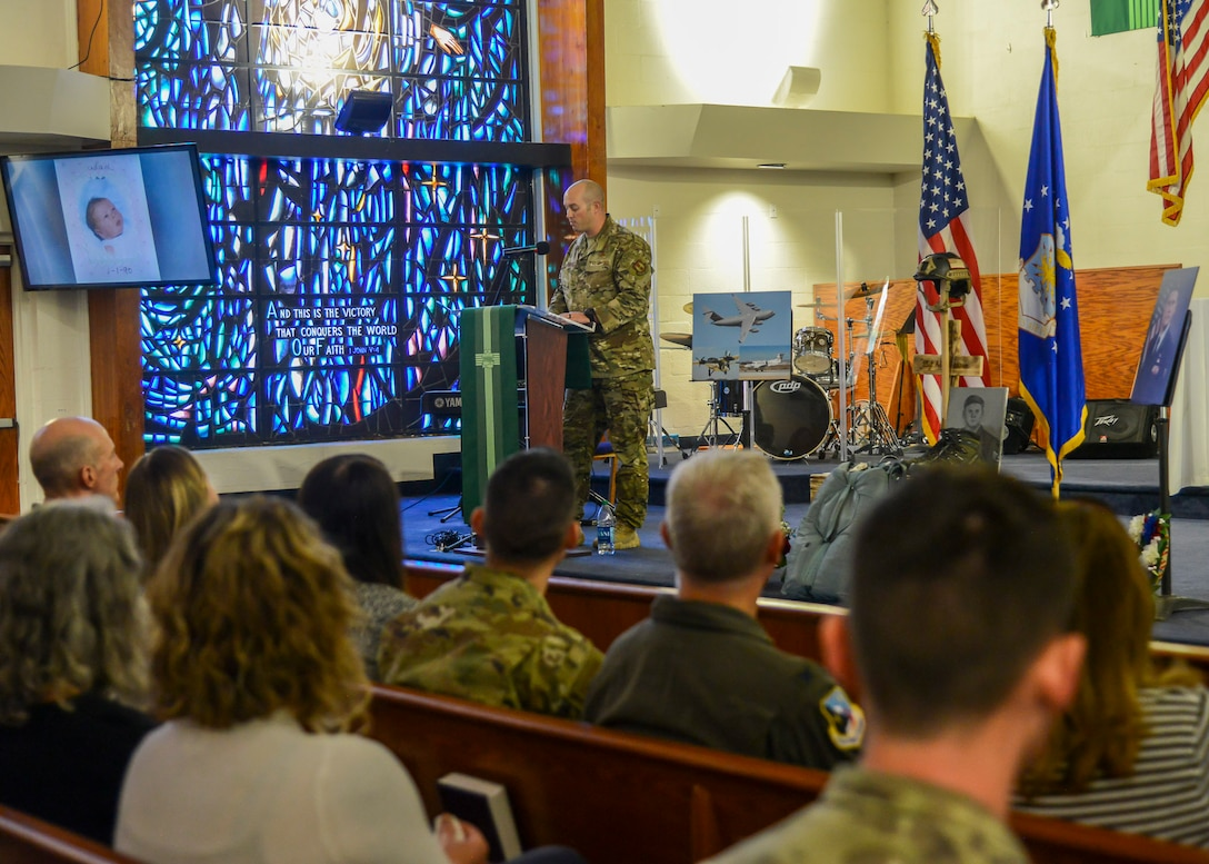 Master Sgt. Brandon Fountain, SERE/Test Parachute Program superintendent, shares his memories of Staff Sgt. Adam Erickson during a during a memorial service in honor of Staff Sgt. Erickson at Edwards Air Force Base, California, Sept. 20. (U.S. Air Force photo by Giancarlo Casem)