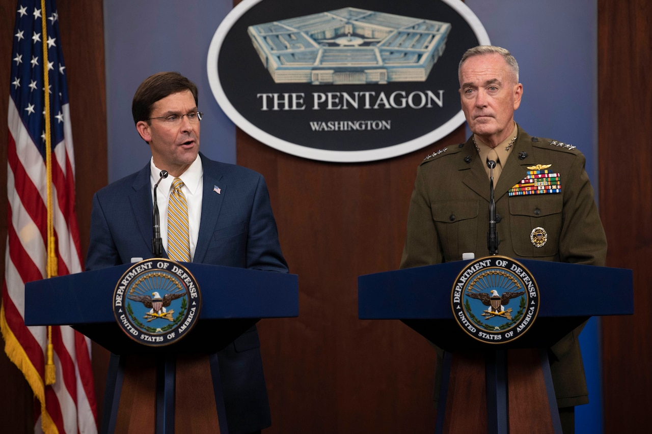 Two defense leaders brief reporters at the Pentagon.