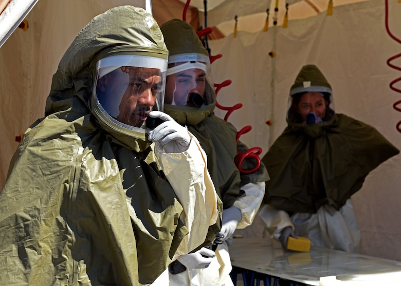 Personnel from the 17th Medical Group receive instructions during their medical in-place decontamination training at the Ross Clinic on Goodfellow Air Force Base, Texas, Sept. 12, 2019. Personnel train on how to properly don their protective gear and how to communicate to disinfect their patients. (U.S. Air Force photo by Airman 1st Class Robyn Hunsinger)
