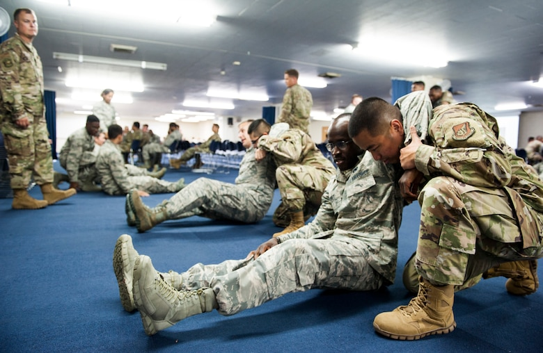Airmen demonstrate the one-man carry technique during Ability to Survive and Operate training at Kadena Air Base, Japan, Sept. 12, 2019. Self-Aid and Buddy Care, an essential part of survival for Airmen, is basic medical care given during loss of life or limb situations until more advanced medical providers arrive. (U.S. Air Force photo by Naoto Anazawa)
